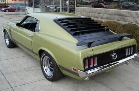 green 1969 Ford Mustang Boss 302